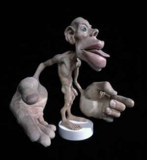 Photograph of a detailed stature of a sensory homunculus, to illustrate that the feet are a rich source of sensation.