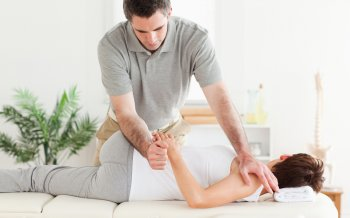 Pregnant woman visiting a Chiropractor